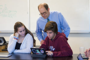 New Hampton students analyze results from a recent biology lab.