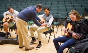 New Hampton Students learn to play the guitar from one of their outstanding teachers.