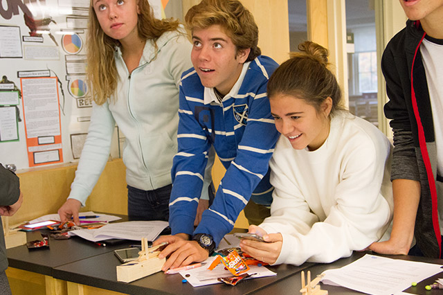 New Hampton School physics students use project based learning to predict the path of Skittles.