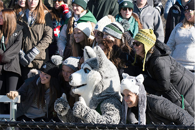 New Hampton School fans pose with Harry the Husky at Powder Keg.