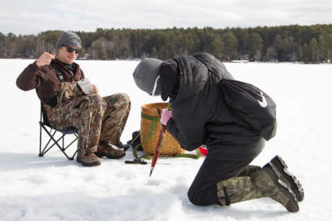 Students ice fishing on a nearby lake in New Hampshire