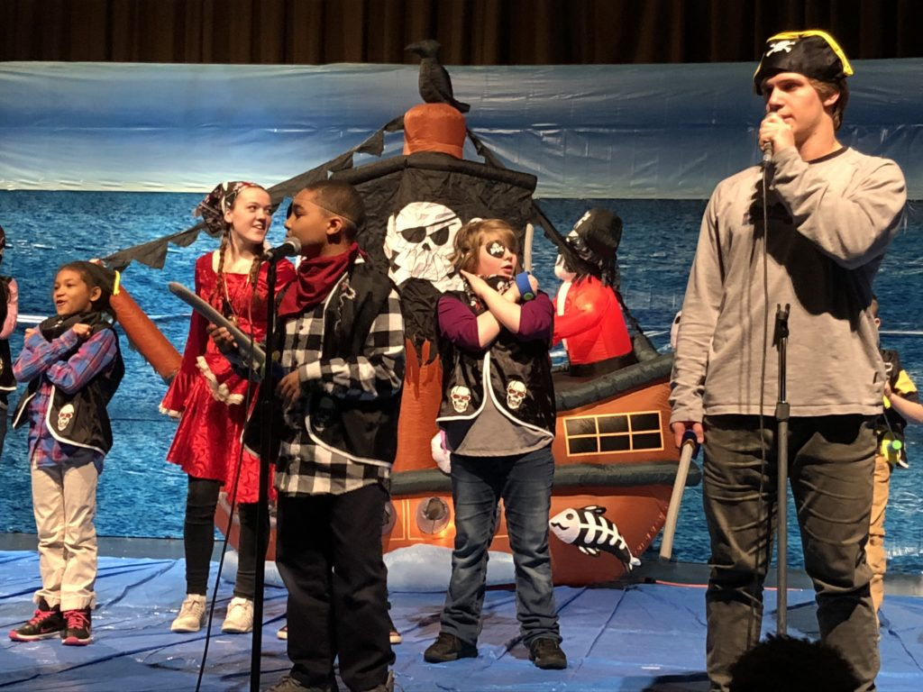 Students on stage as pirates.