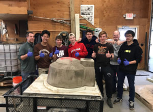 Students and brick oven