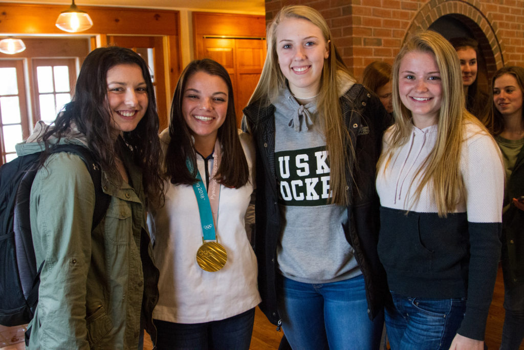 Olympic Medalist Cayla Barnes '17 visits New Hampton School including former teammates.