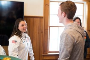 Cayla Barnes '17 speaking with students