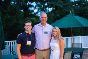 Head of School Joe Williams with co-presidents Johnny and Kelly at an August welcome dinner.