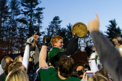 New Hampton School football players and students celebrate their Powder Keg victory.