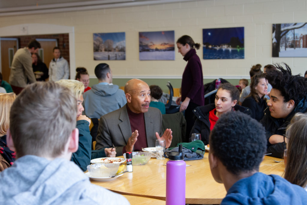 Alumni in Residence Thomas Motley with students at lunch