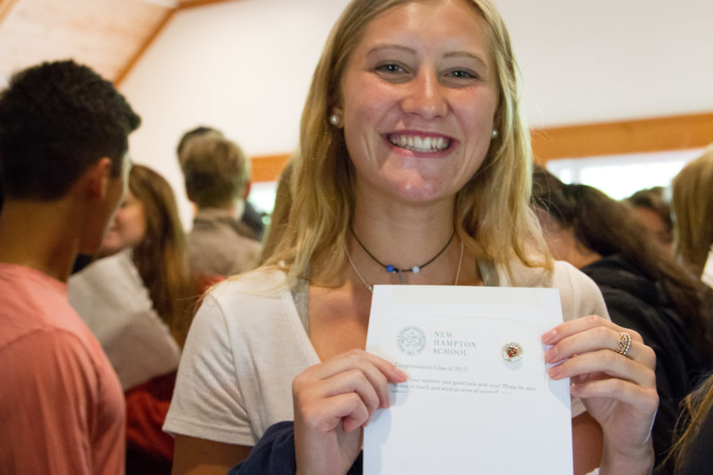 Alumna Katie George captures a moment with her alumni pin.