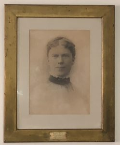Miss Butts in a portrait, an early teacher at New Hampton School.