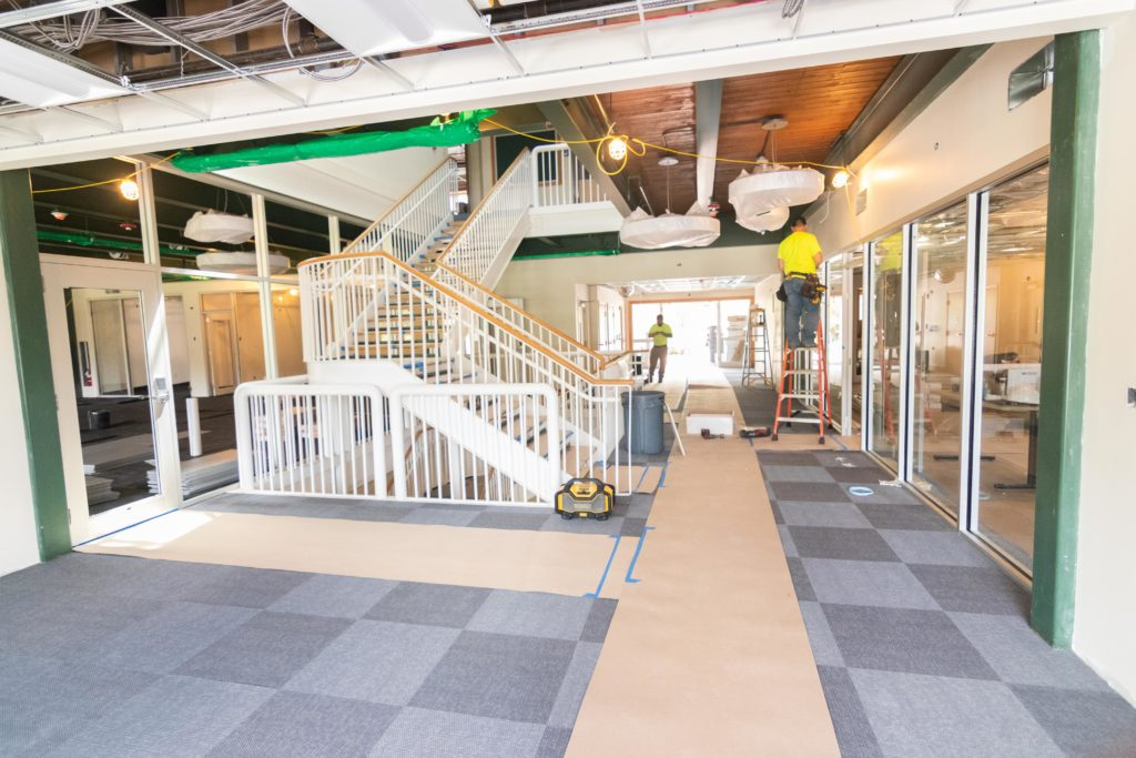 Construction on the interior of an academic building with new carpet; future home of the innovation center