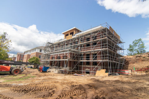 Exterior of brick building surrounded by metal scaffolding